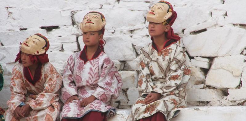 three bhutan monks
