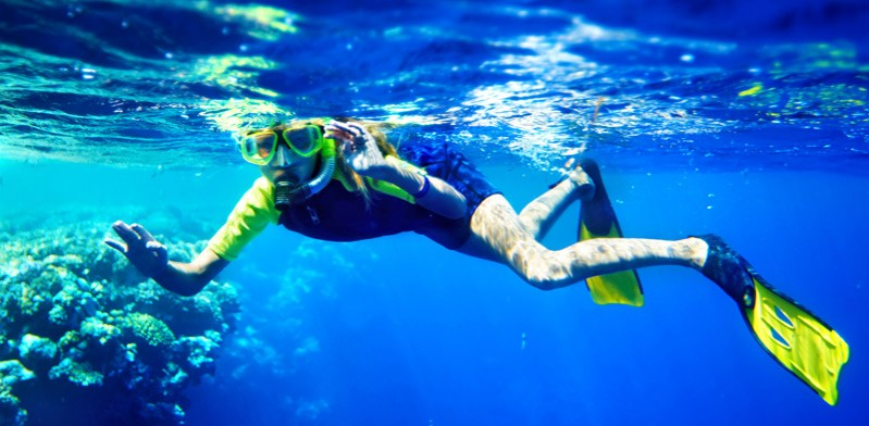 male snorkelling in the ocean