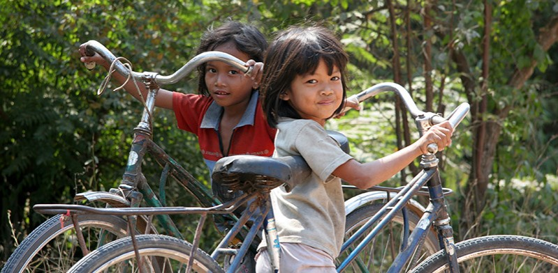 two children with bikes