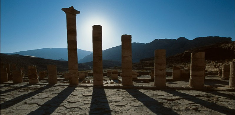 ruins in jordan with sun setting behind