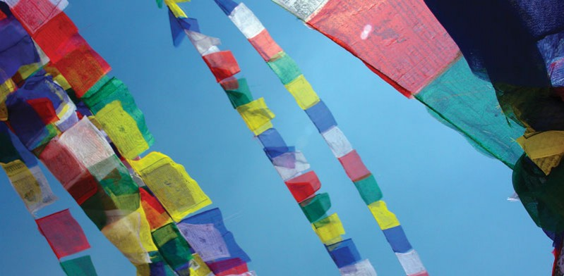 prayer flags flying in the air in nepal