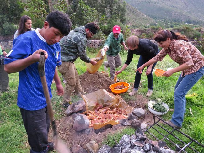 Preparing Pachamanca, a traditional Peruvian dish baked on hot stones