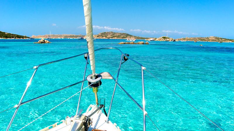 A boat sails into Sardinia