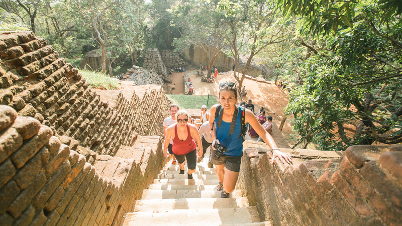 Travellers climbing steps to Sigiriya in Sri Lanka
