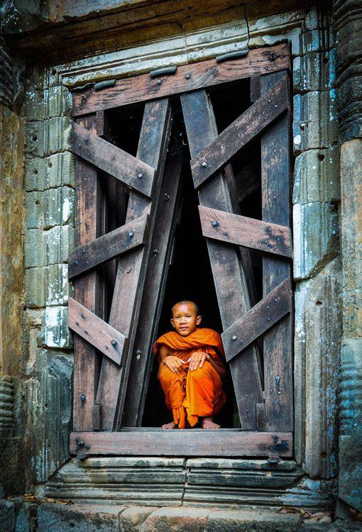 cambodia_angkor-wat_monk-sitting-doorway_Richard-Misquitta_WINNER