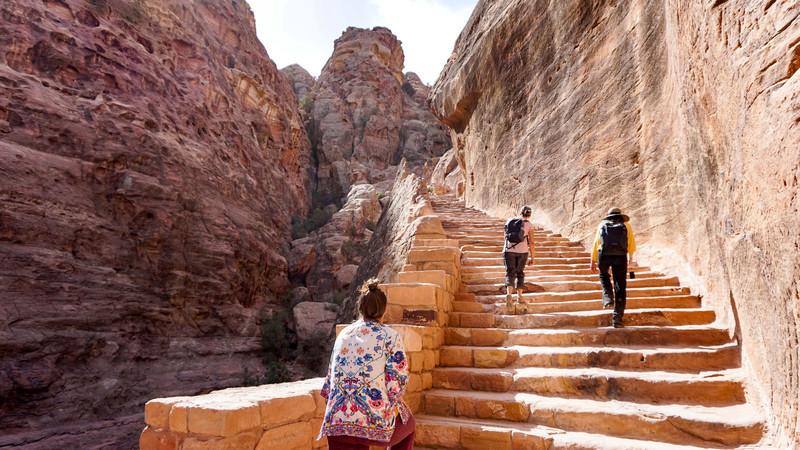 Climbing the stairs at Petra, Jordan