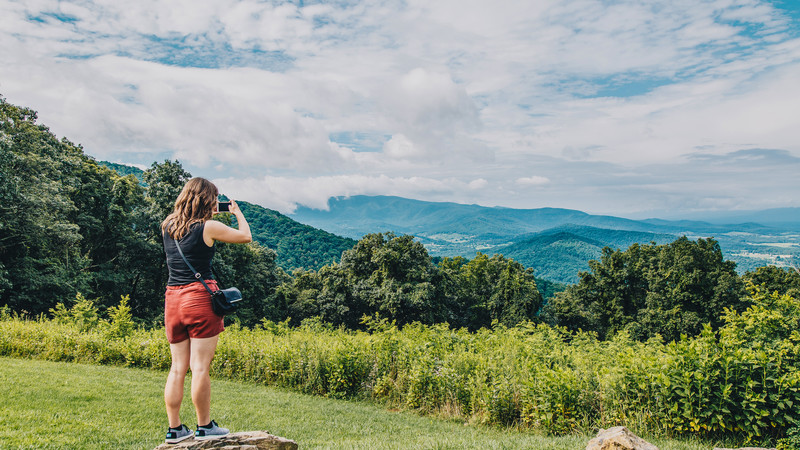 Woman takes photo in USA national park
