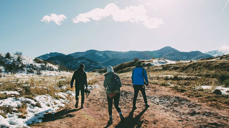 Three friends hiking in snow