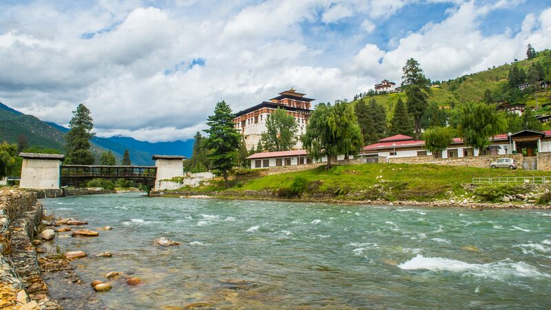 Old monastery in Bhutan next to a river