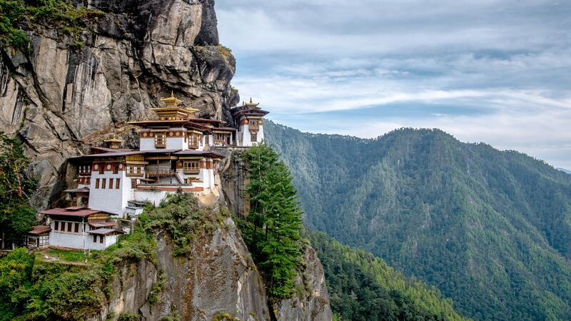 Ancient monastery on the side of a mountain in Bhutan