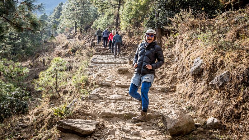 A smiling hiker on a hiking trail in Nepal