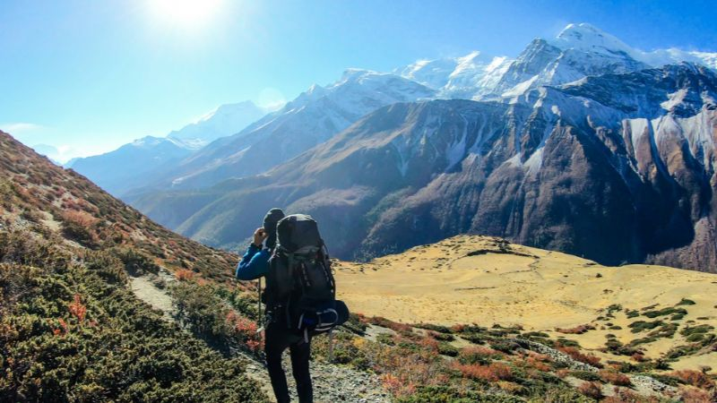 A hiker wearing a backpack on the Annapurna trail