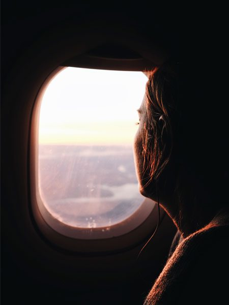 airplane-window-flying-unsplash