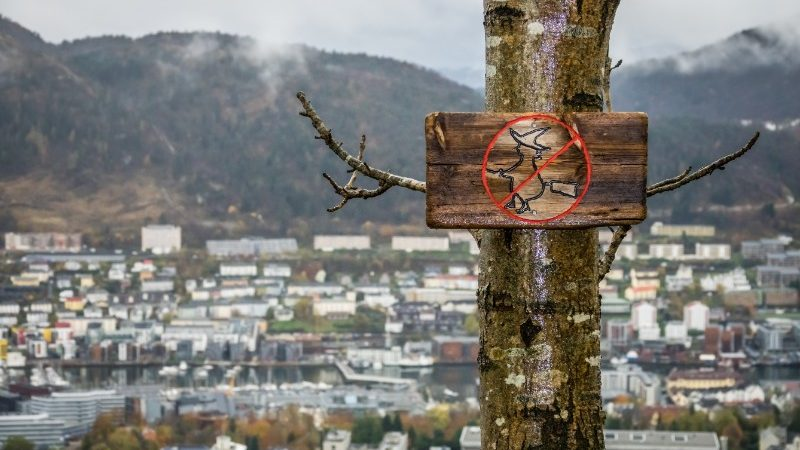 A wooden sign wards off witches in Norway at Christmas