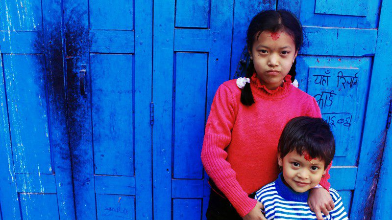 Orphanage_tourism_nepal_kathmandu_children-red-top-blue-door