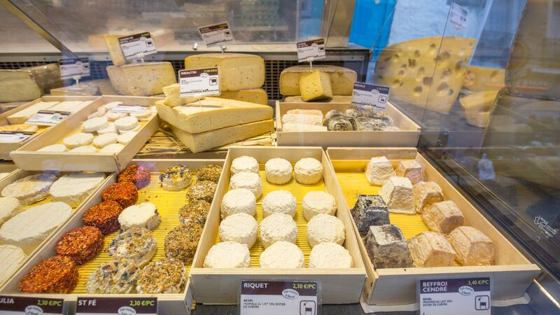A cheese stall at the market.