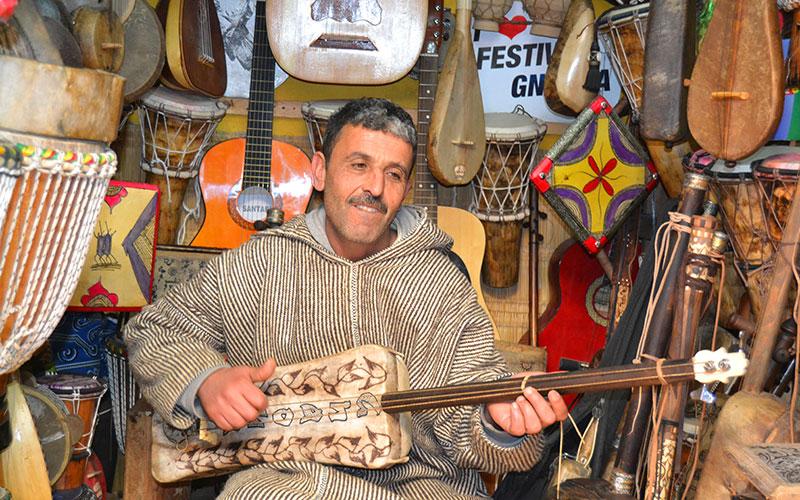 A musician plays a guembri in Essaouira, south Morocco