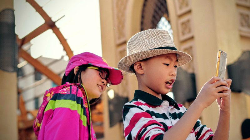 Kids taking photo on smartphone