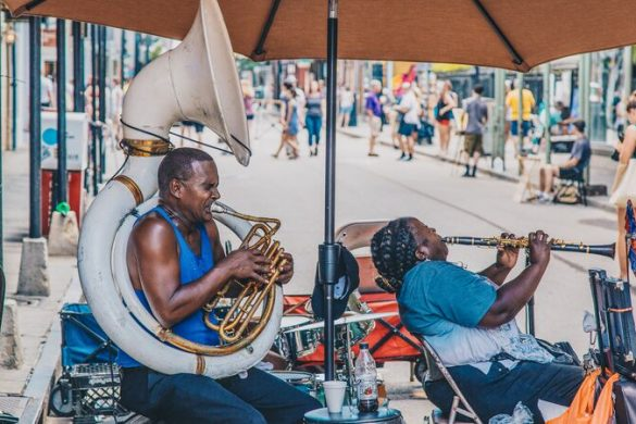A brass band playing on a street corner in New Orleans