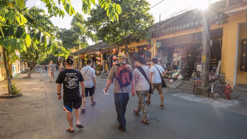 Group walking through Hoi An, Vietnam