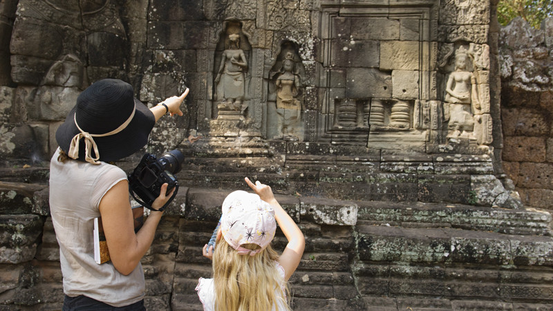 Mother and daughter studying Angkor Wat