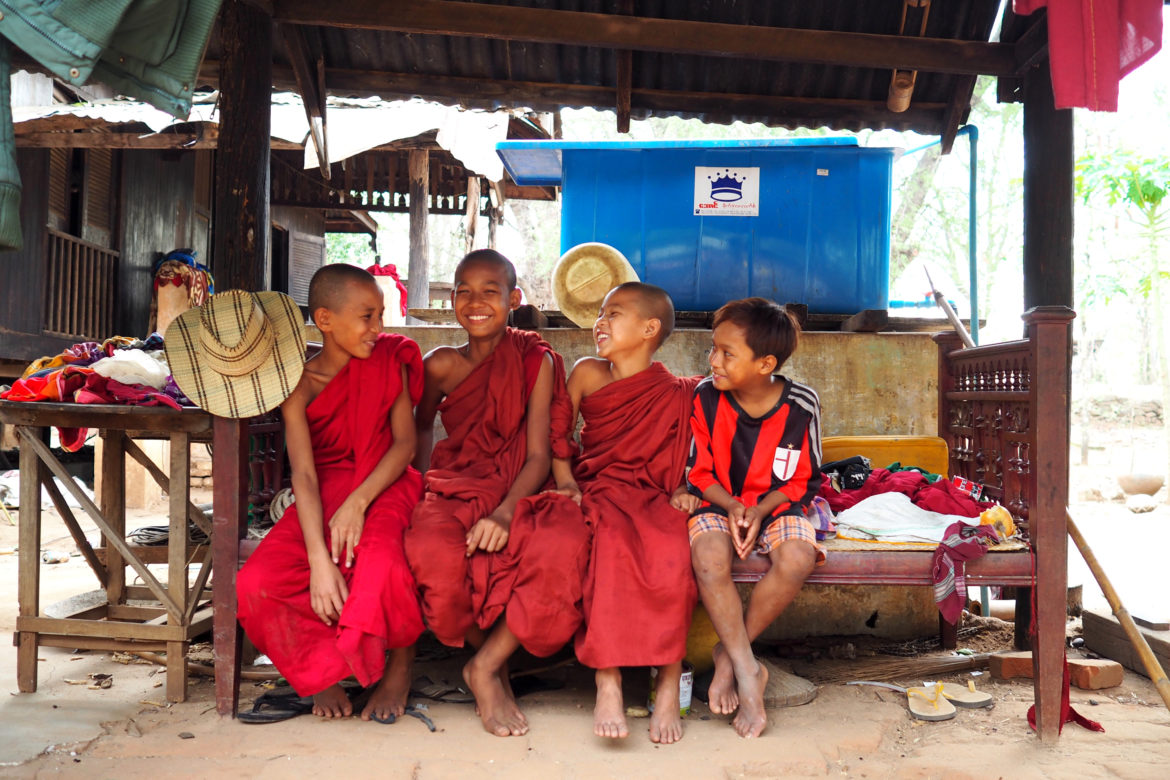 Community-based tourism in Myanmar: young monks share a joke with a friend in Myaing