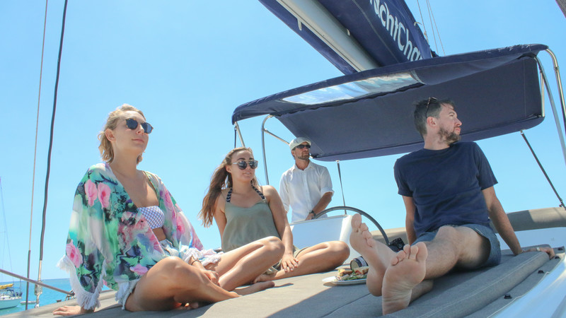 Three passengers and Mike aboard the boat.