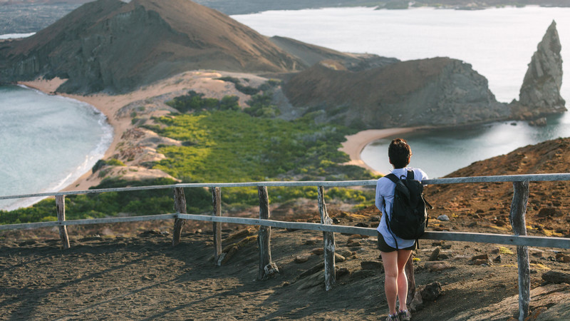 A hiker looks out over the Galapagos Islands