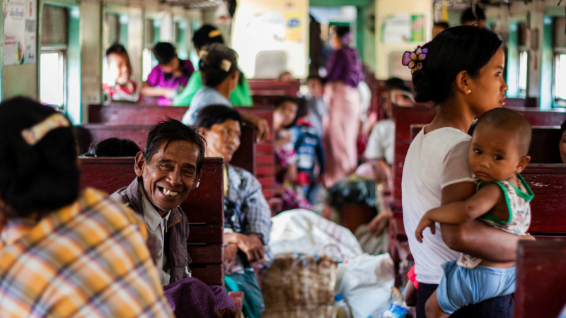 Cheerful local man on a train in Myanmar