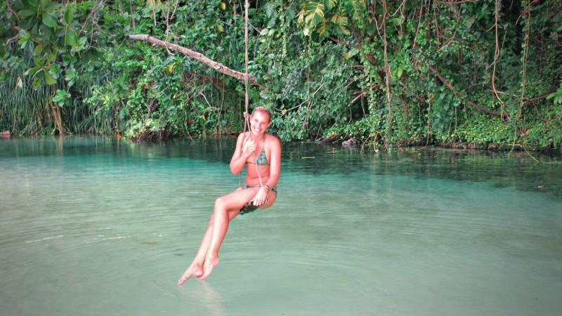 Swinging over a lagoon in Jamaica