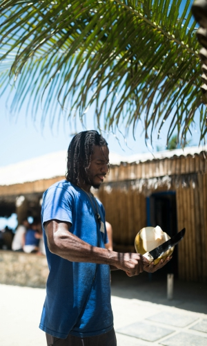 Local opens a coconut in Jamaica