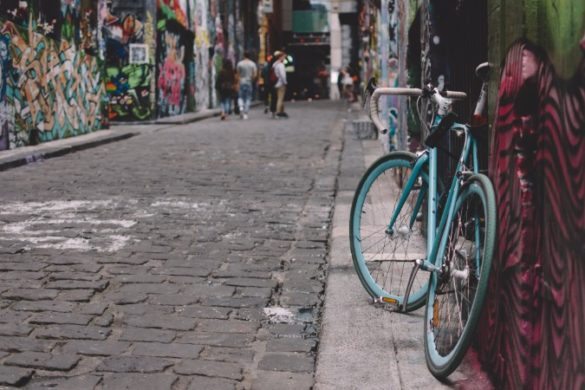 A bike leans up against a graffiti-covered wall in Melbourne