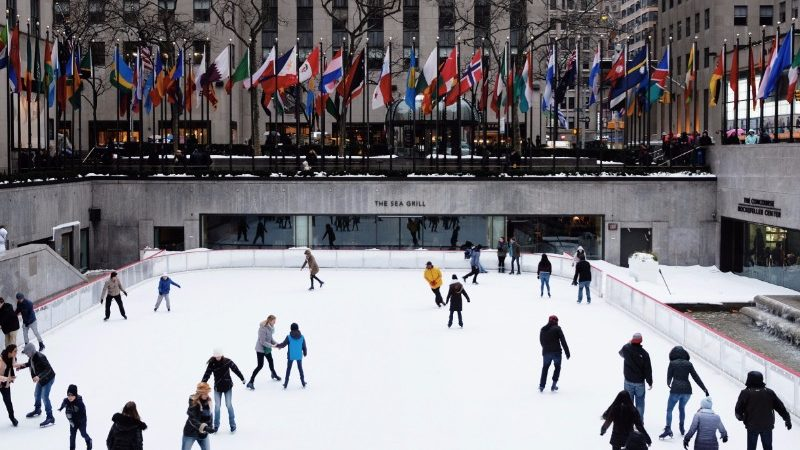 People ice-skating at Rockefeller Plaza in New York City.
