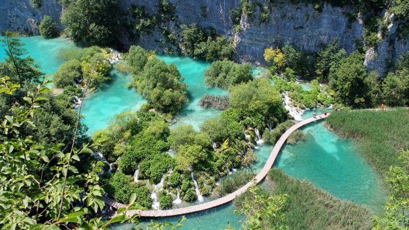 A boardwalk winds through Plitvice Lakes National Park, Croatia