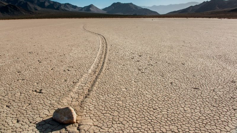 A rock slithers across Death Valley