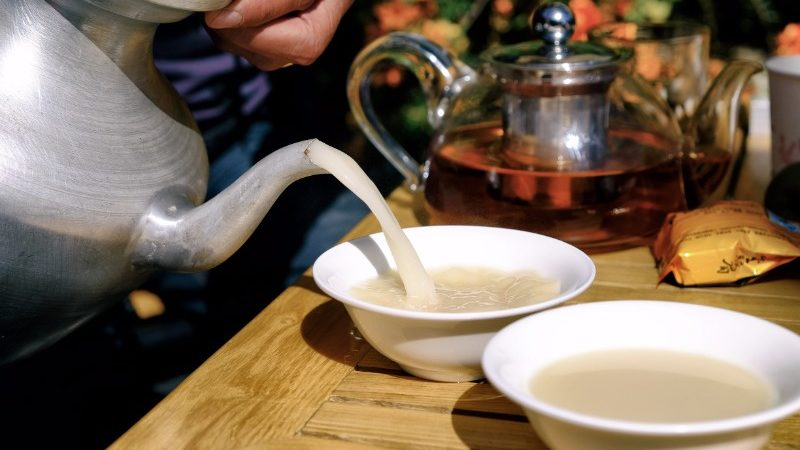 Butter tea is poured from a teapot