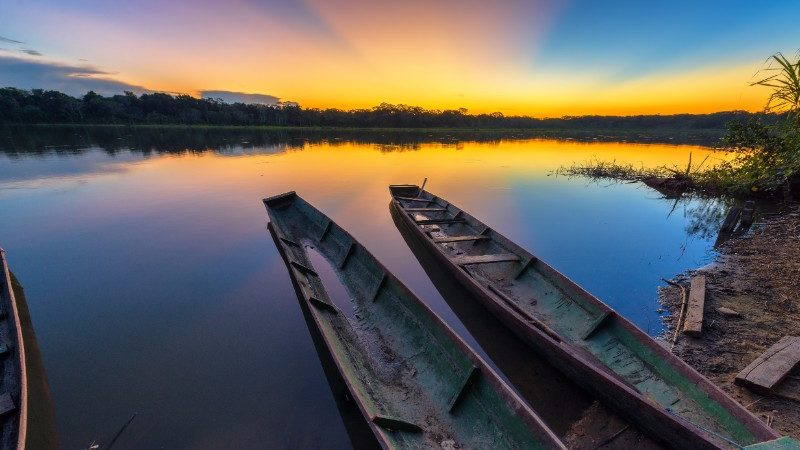 Two canoes in the Madidi National Park at sunset
