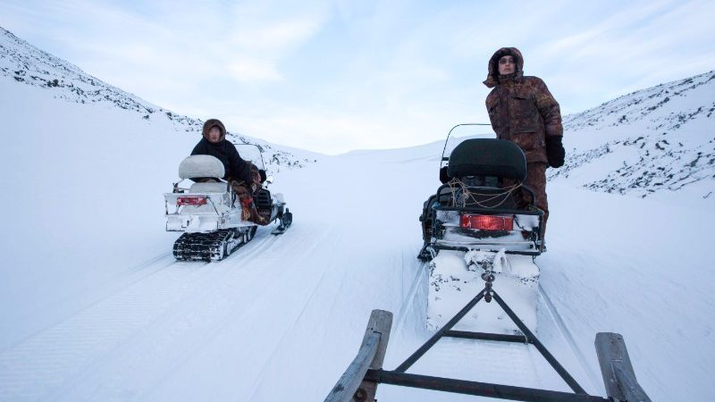 Snowmobiling across the ice in Siberia