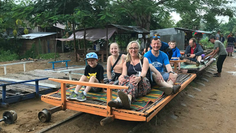 Helen's family riding the Bamboo Train