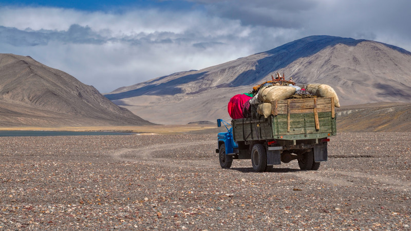 Loaded truck travels along the Pamir Highway.