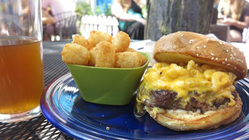 Mac 'n' cheeseburger with a side of tater tots.