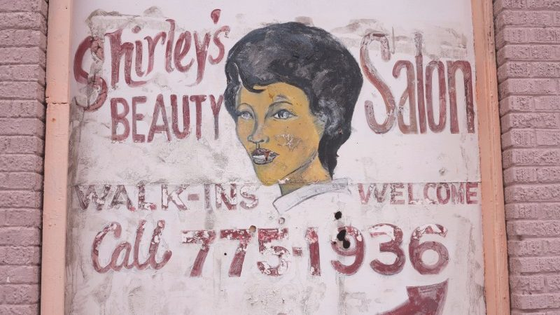 A painted mural advertising a beauty salon