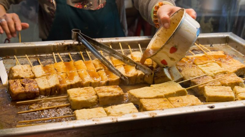 A vendor prepares stinky tofu in Taiwan