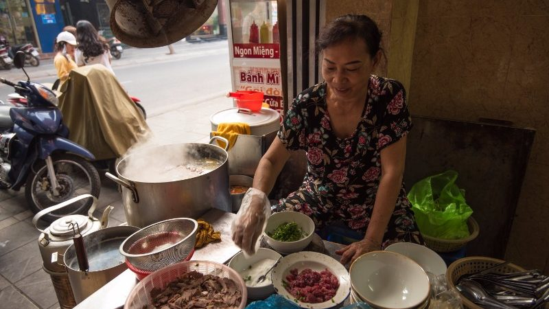 A woman sells pho in Hanoi