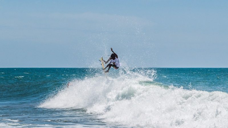surfer at arugam beach sri lanka