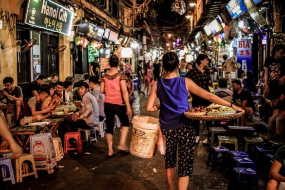A busy Hanoi street filled with people