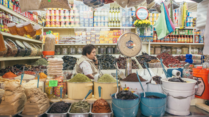 A woman works at a stall in Mexico City