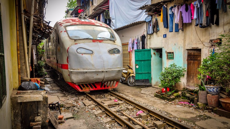 A train rumbles through Hanoi's Old Town