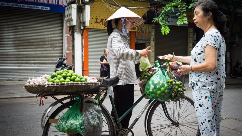 A woman sells limes on a Hanoi street