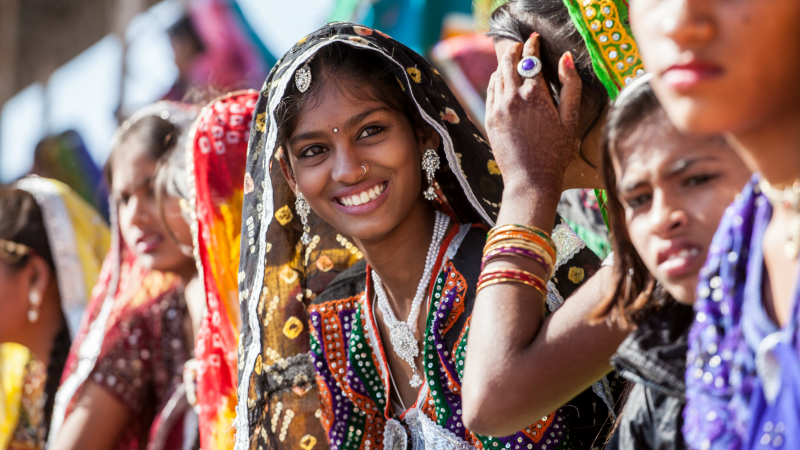 A young woman smiles at Pushkar Camel Fair
